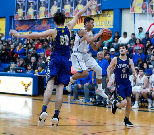 Odem's Matthew Ramirez passes the ball during the basketball game against Aransas Pass on Friday, January 18, 2019. Odem won 48-30.