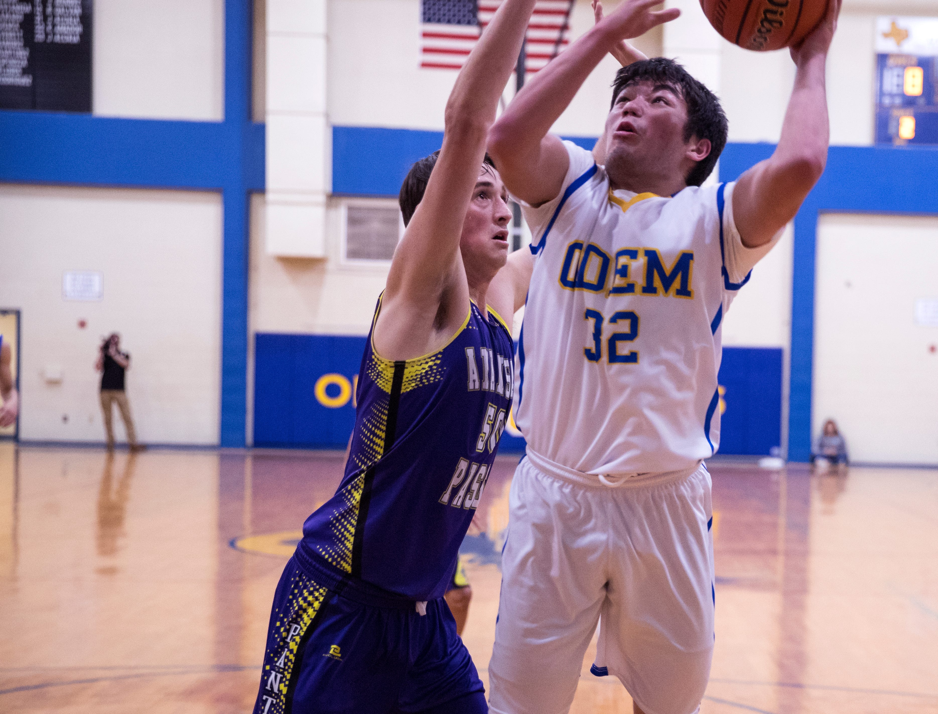 Odem's Josh Rodriguez goes up for a basket as Aransas Pass' Jared Gentry waits for the rebound on Friday, January 18, 2019. Odem won 48-30.