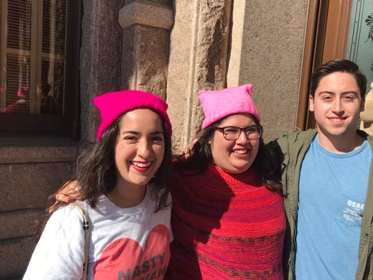 Cousins Alejandra Lucio, 25, Ana Lucio, 27, and Andres Garza, 23, at the women's rally at the Texas Capitol on Jan. 19, 2019.
