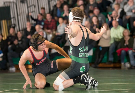 Camden Catholic's Lucas Revano, right, reacts after pinning Jackson Memorial's Mike Rauch during the 145 lb. bout of Friday's wrestling match held at Camden Catholic High School in Cherry Hill.
