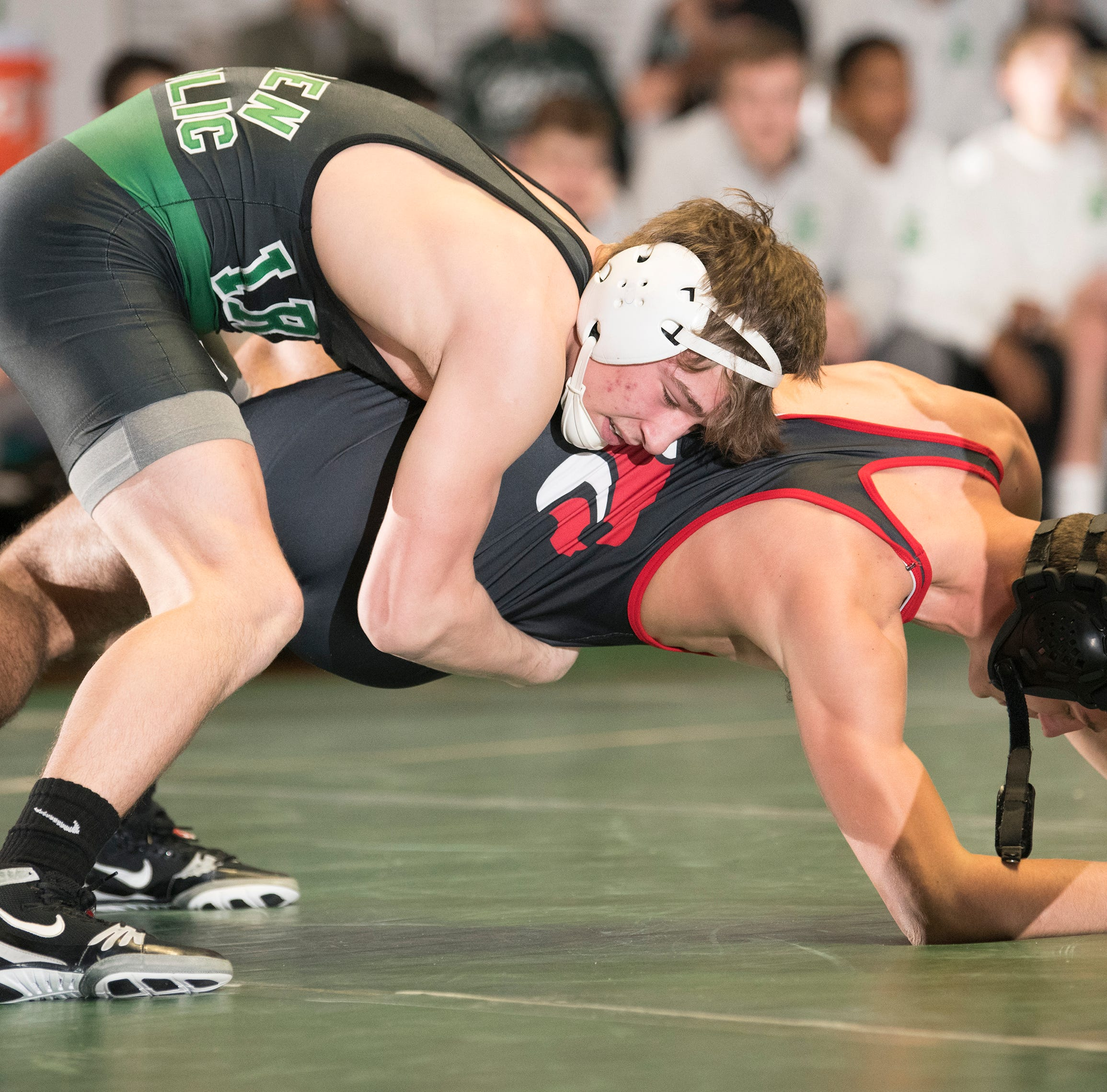H.S. wrestling: Revano packs a punch in return, Irish knock out Jackson