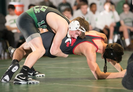 Camden Catholic's Lucas Revano controls Jackson Memorial's Mike Rauch during the 145 lb bout of Friday's wrestling match held at Camden Catholic High School in Cherry Hill.  Revano won the bout by pin.