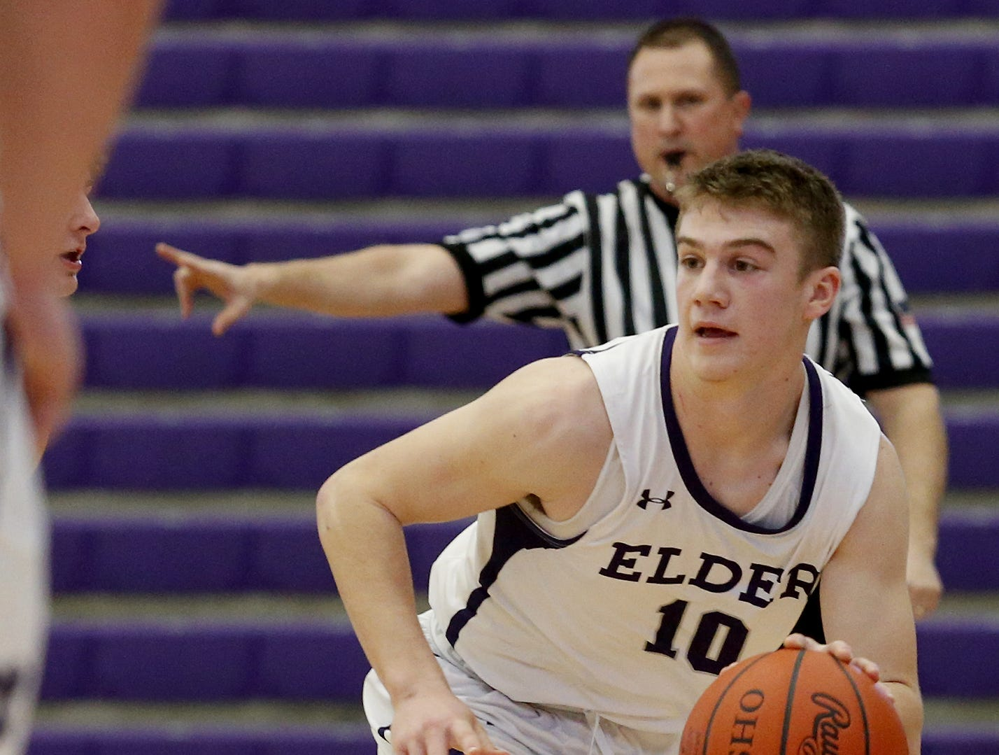 Elder guard Matthew Luebbe brings the ball up court against Covington Catholic during the Midwest King Classic at Jerry Lucas Court in Wade E. Miller Arena in Middletown Saturday, Jan. 19, 2019.
