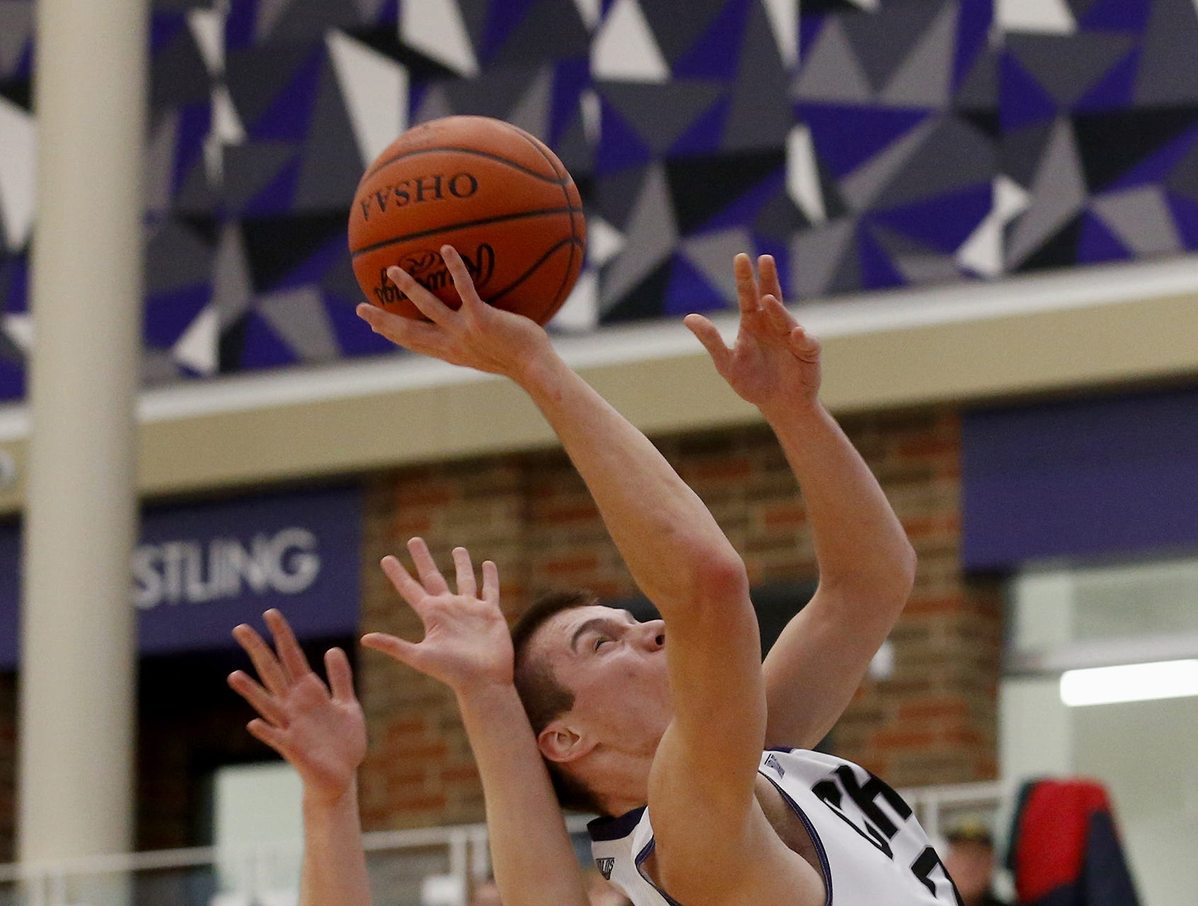 Cincinnati Hills Christian Academy guard Jack Kolar draws a shooting foul from Sycamore guard Oliver Wittenbaum during the Midwest King Classic at Jerry Lucas Court in Wade E. Miller Arena in Middletown Saturday, Jan. 19, 2019.