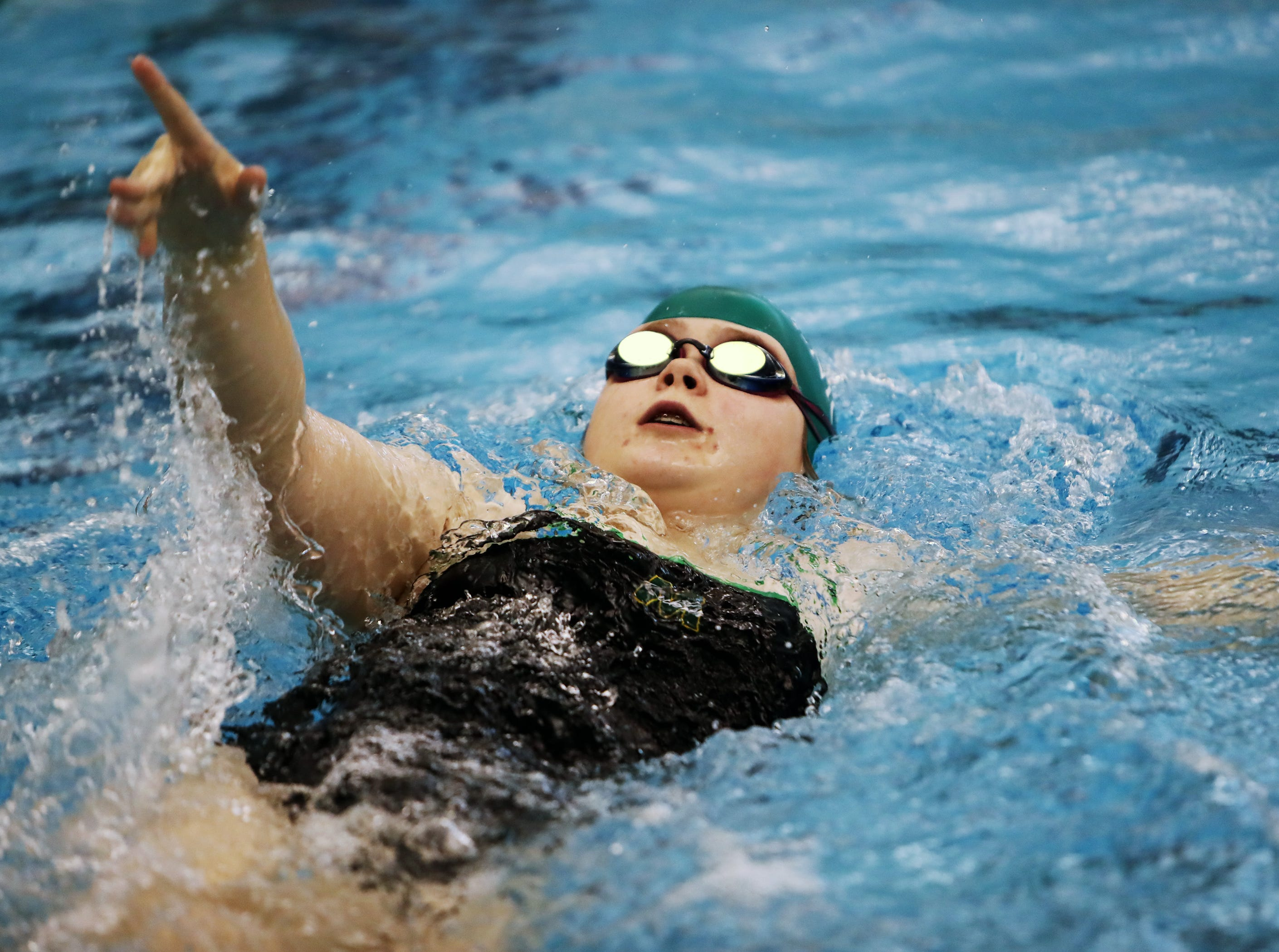 Sophie Gephardt from McNicholas competes in the girls 100-yard backstroke at the SW Ohio Swim Classic at Mason.
