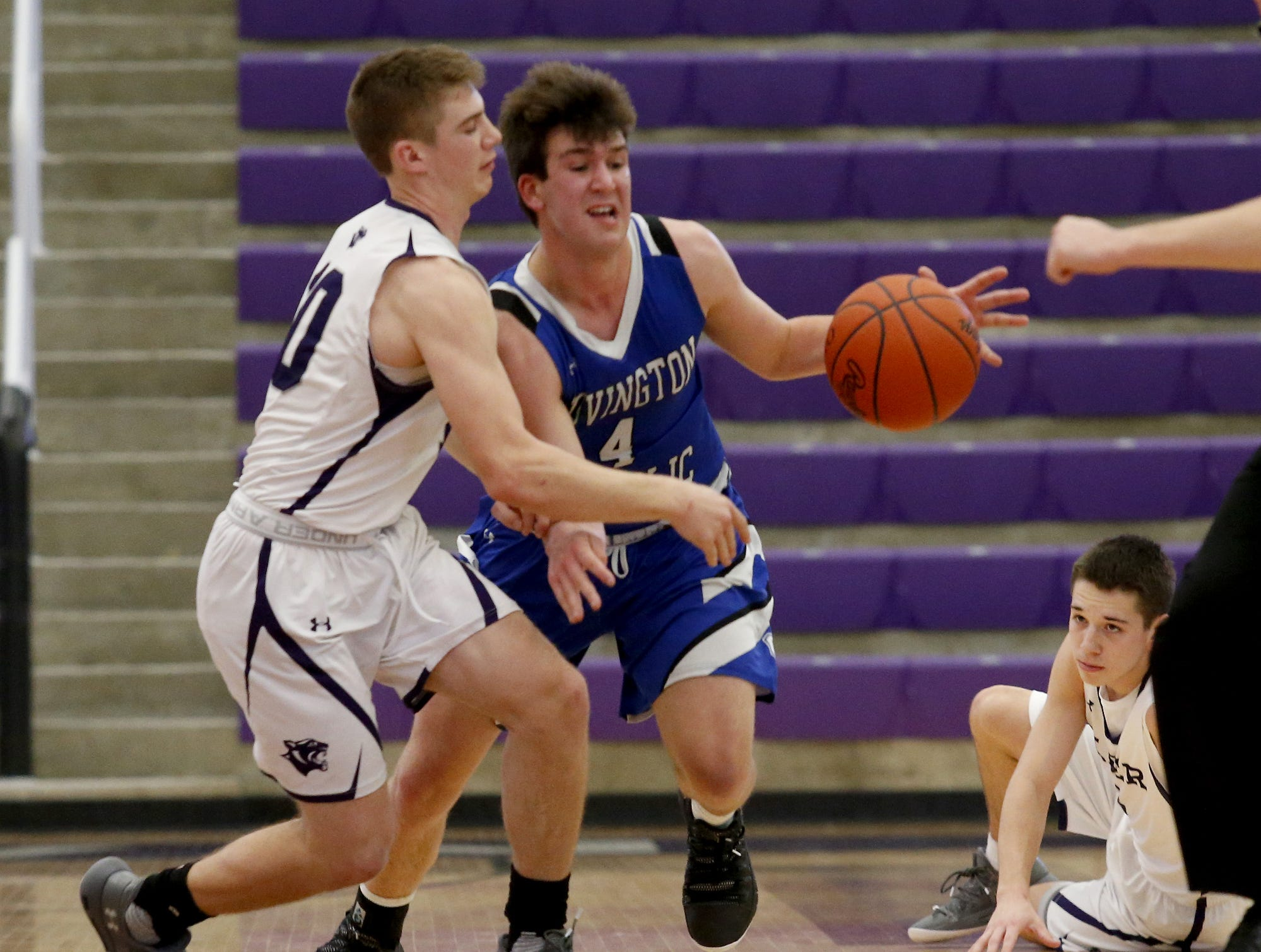 Covington Catholic forward Joey Moser tries to keep control as Elder guard Matthew Luebbe pressures during the Midwest King Classic at Jerry Lucas Court in Wade E. Miller Arena in Middletown Saturday, Jan. 19, 2019.