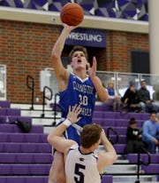 Covington Catholic forward Nick Thelen shoots and draws a foul from Elder forward Michael Bittner during the Midwest King Classic at Jerry Lucas Court in Wade E. Miller Arena in Middletown Saturday, Jan. 19, 2019.