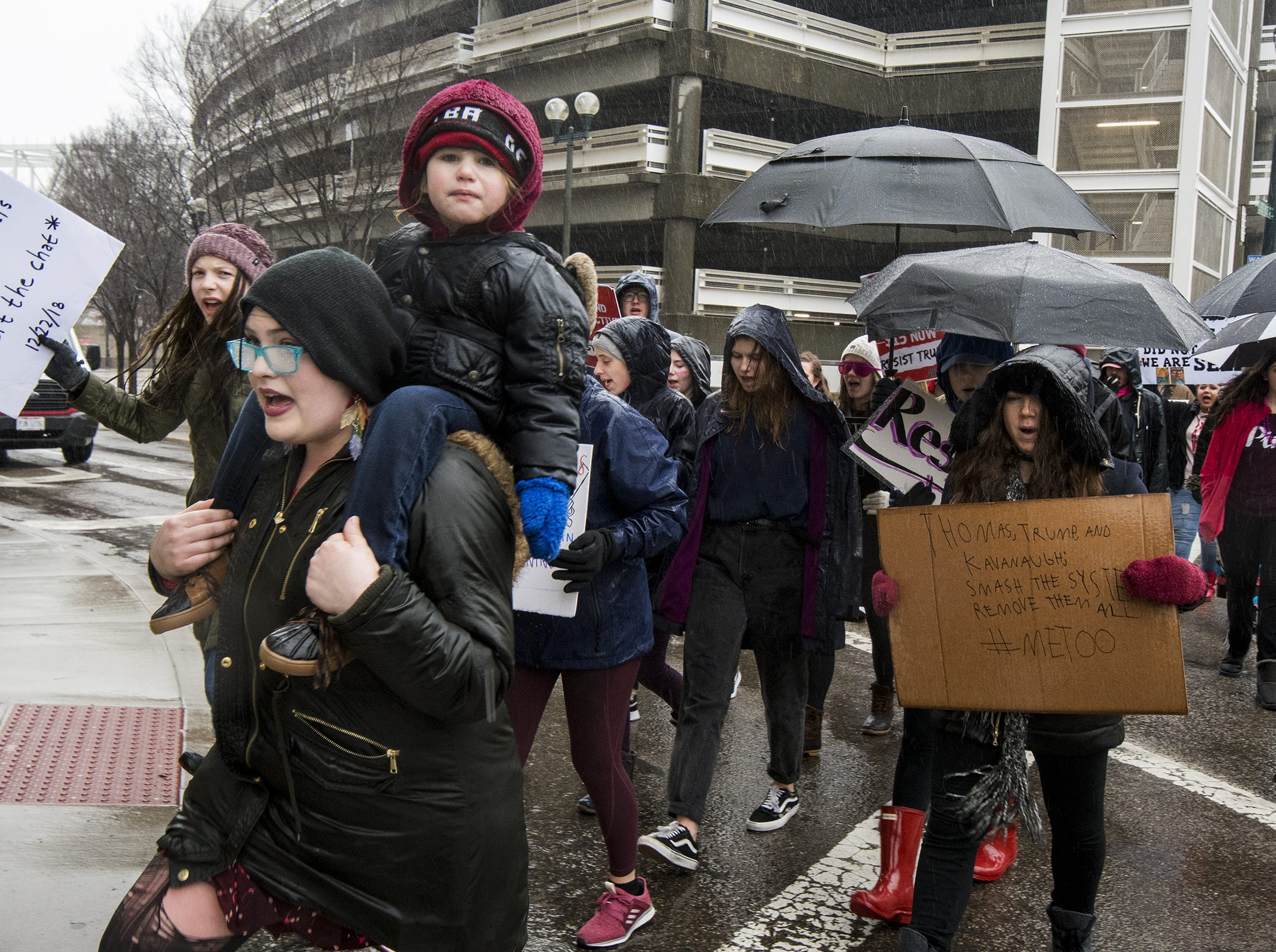 Ayla carries son Akira,3, during the 2019 Women's March organized by the Cincinnati chapters of Socialist Alternative, Democratic Socialists of America and the International Socialist Organization Saturday, January 19, 2019 in Cincinnati, Ohio.