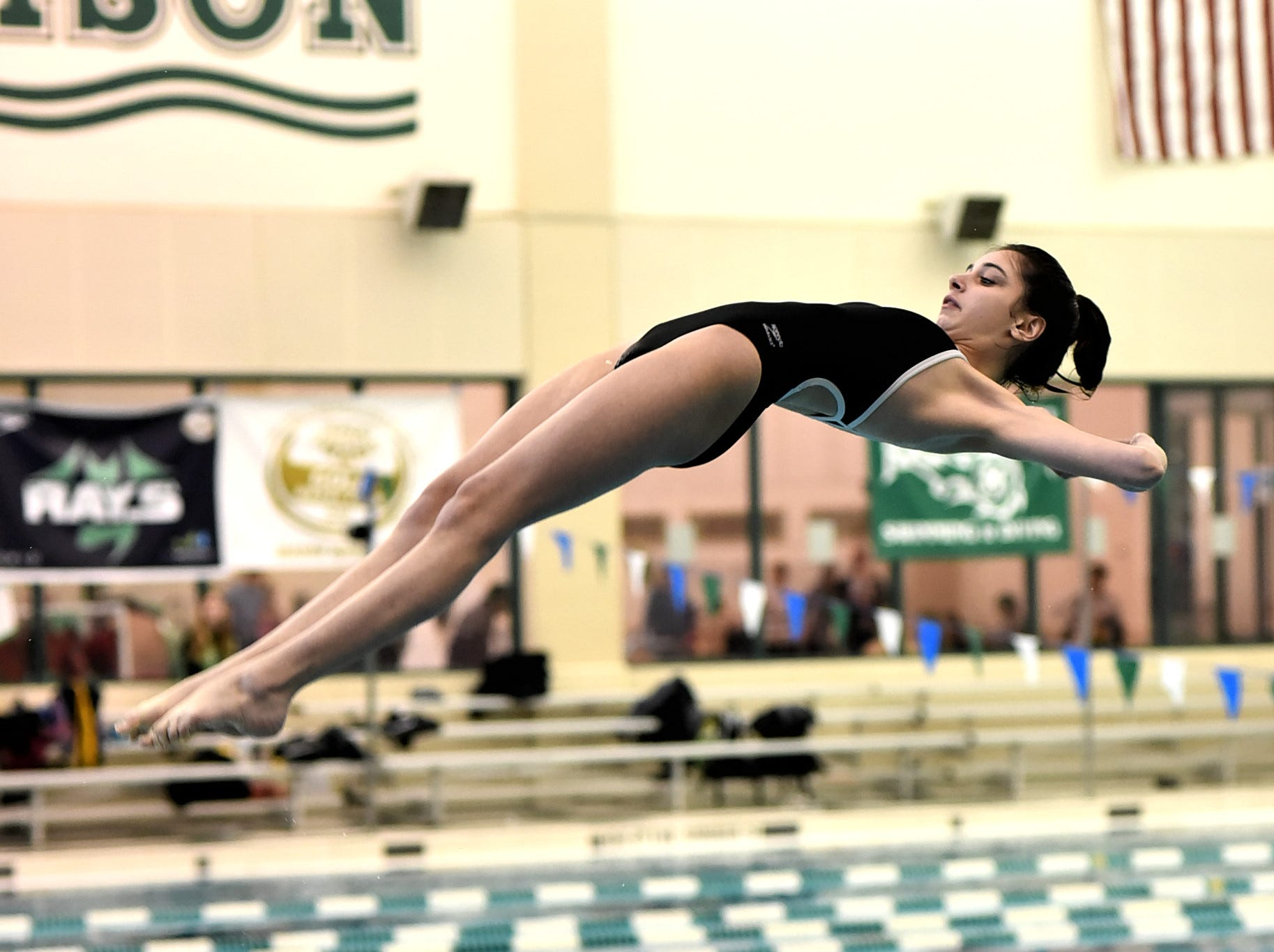 Lauren Lombardo of Mason bends off of the board as she dives in the preliminary round at the Southwest Ohio Swimming and Diving Classic, January 19, 2019.