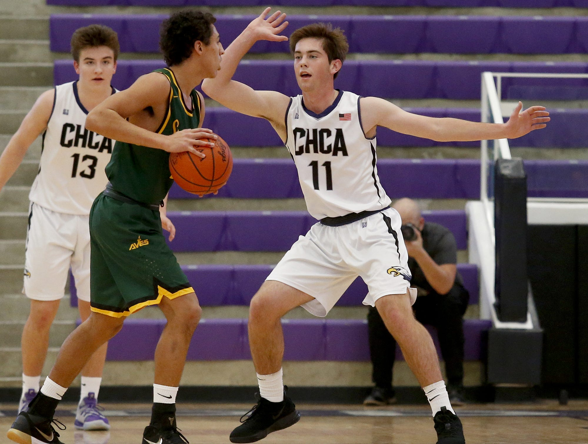 Sycamore guard Davis NiBlack is covered by Cincinnati Hills Christian Academy forward Jack Sonne during the Midwest King Classic at Jerry Lucas Court in Wade E. Miller Arena in Middletown Saturday, Jan. 19, 2019.