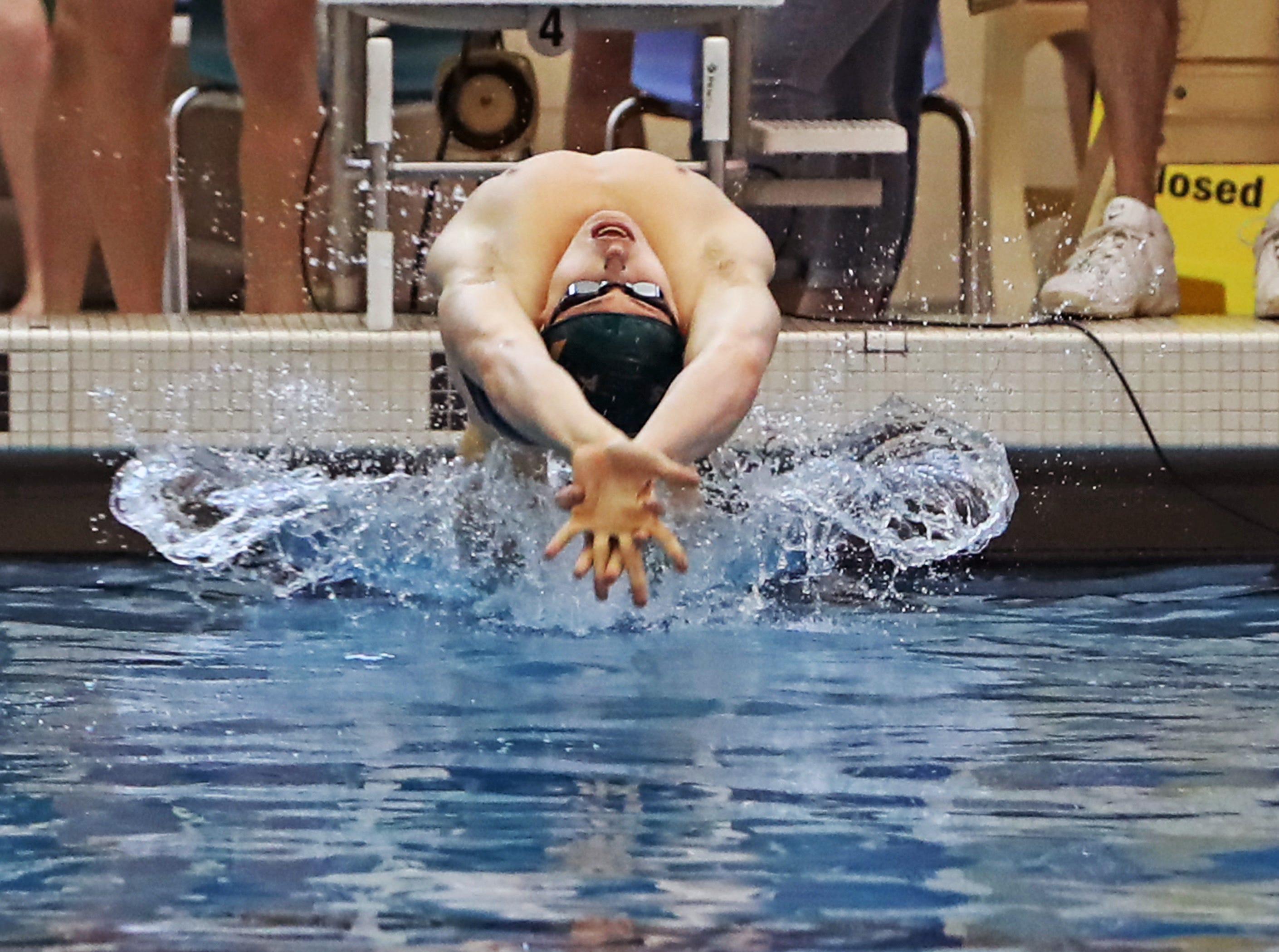 Carson Foster from Sycamore is off to a fast start for the back stroke portion of the boys 400 yard relay at the Southwest Ohio Swim Classic in Mason, Ohio.