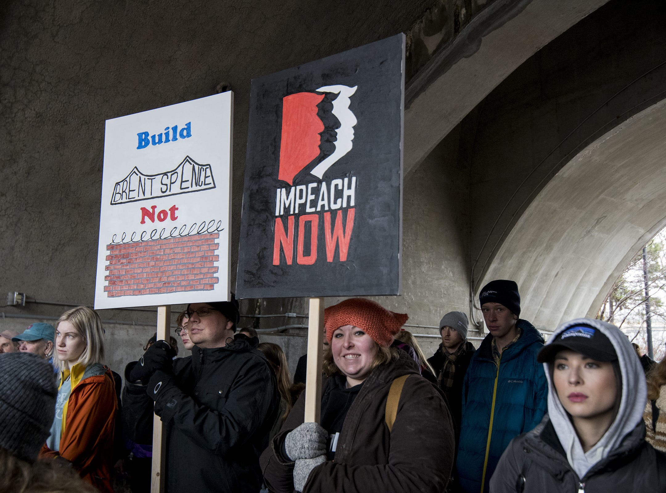 Anthony Pankala and Jeanette Geisler hold sign of protest during the 2019 Women's March organized by the Cincinnati chapters of Socialist Alternative, Democratic Socialists of America and the International Socialist Organization Saturday, January 19, 2019 in Cincinnati, Ohio.