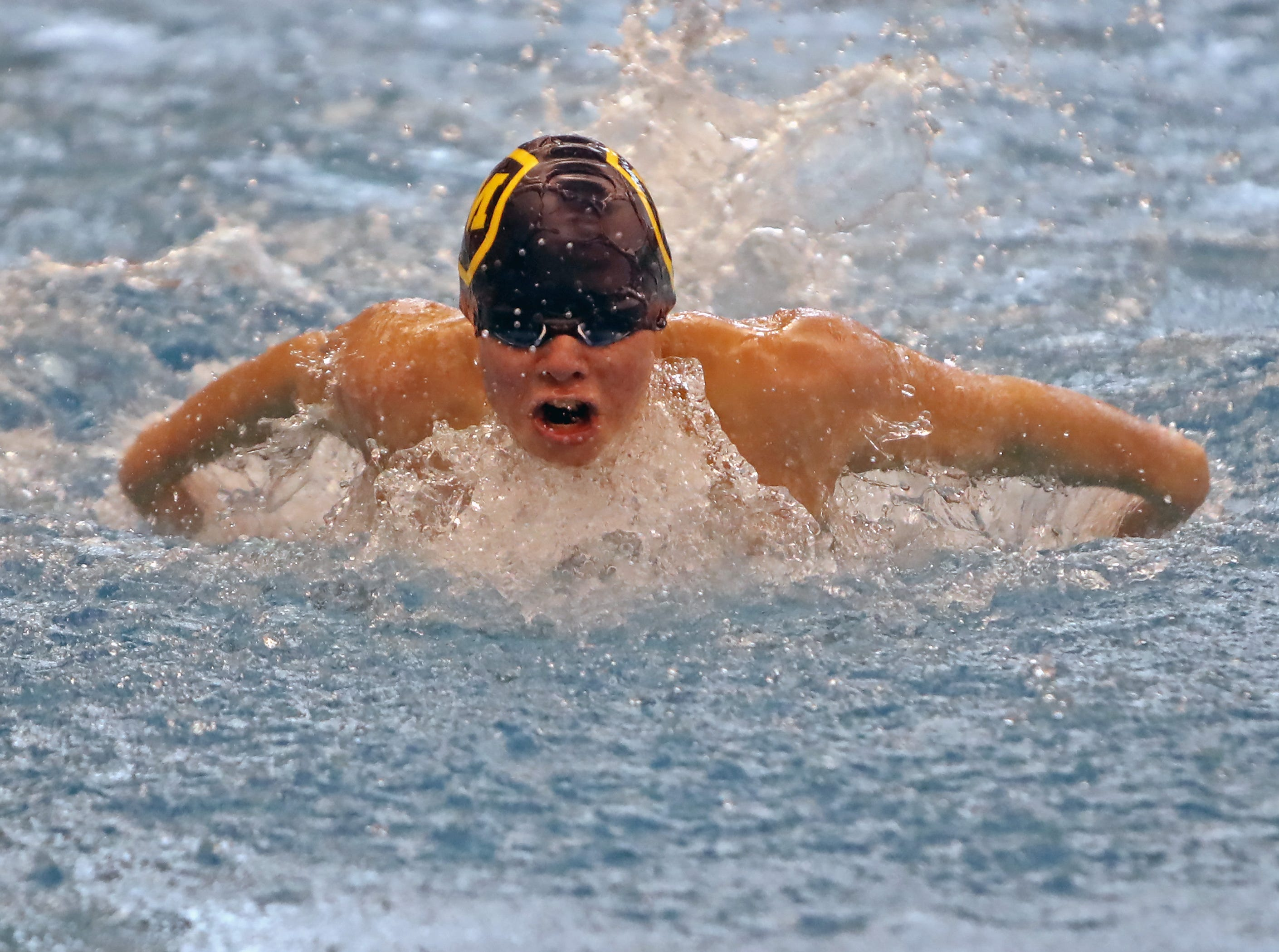 Mitch Garboden from Moeller competes in the boys 100-yard butterfly at the SW Ohio Swim Classic at Mason.