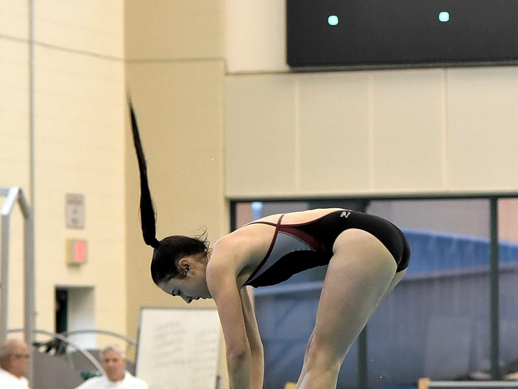 Celia Ball of Kings comes off of the board in full concentration as she dives at the Southwest Ohio Swimming and Diving Classic, January 19, 2019.
