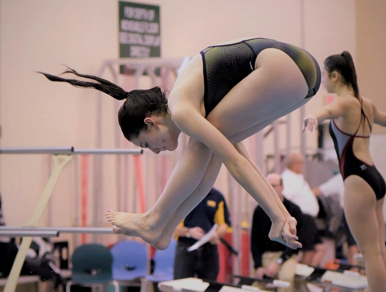 Olivia Zilliox of Walnut Hills completes a warm up dive at the Southwest Ohio Swimming and Diving Classic, January 19, 2019.
