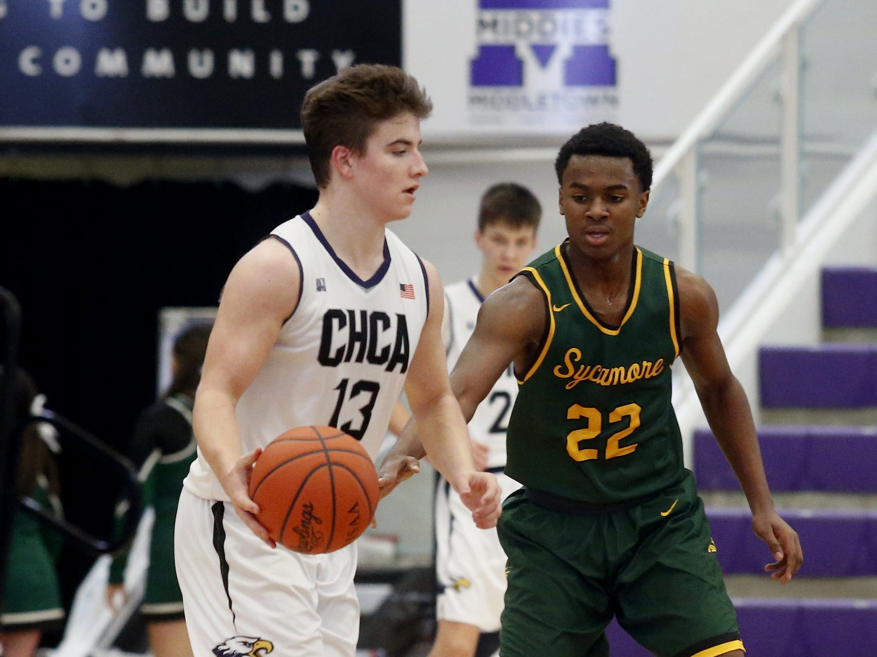 Cincinnati Hills Christian Academy guard Cole Fisher is covered by Sycamore guard Justin Williams during the Midwest King Classic at Jerry Lucas Court in Wade E. Miller Arena in Middletown Saturday, Jan. 19, 2019.