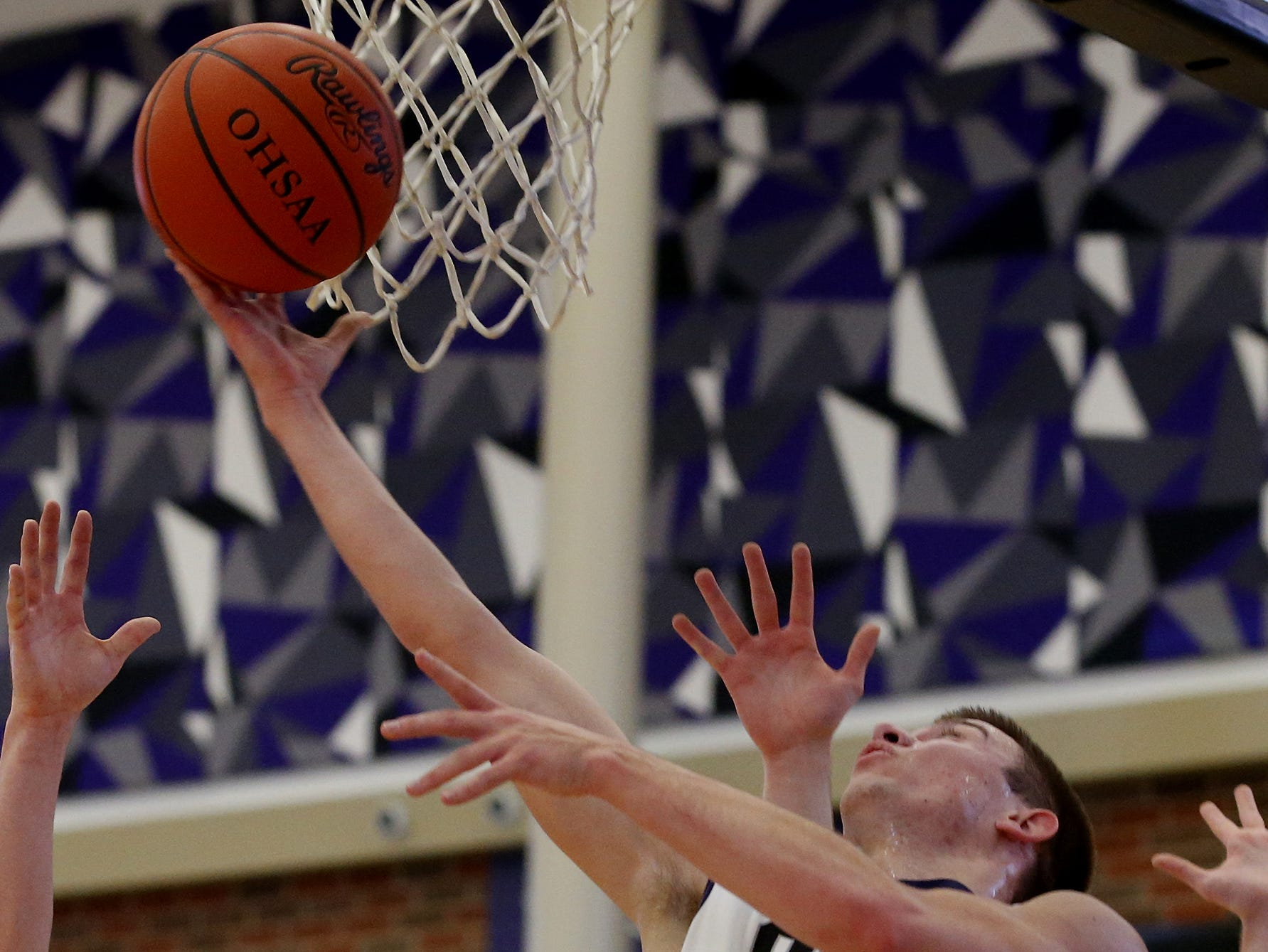 Cincinnati Hills Christian Academy guard Jack Kolar scores against Sycamore during the Midwest King Classic at Jerry Lucas Court in Wade E. Miller Arena in Middletown Saturday, Jan. 19, 2019.