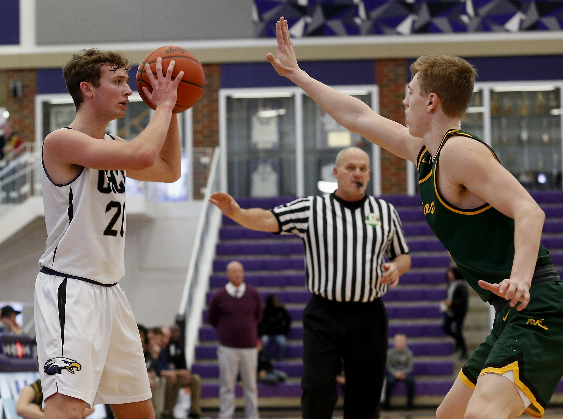 Cincinnati Hills Christian Academy point guard Austin Arthurs is covered by Sycamore guard Ben Yuskewich during the Midwest King Classic at Jerry Lucas Court in Wade E. Miller Arena in Middletown Saturday, Jan. 19, 2019.