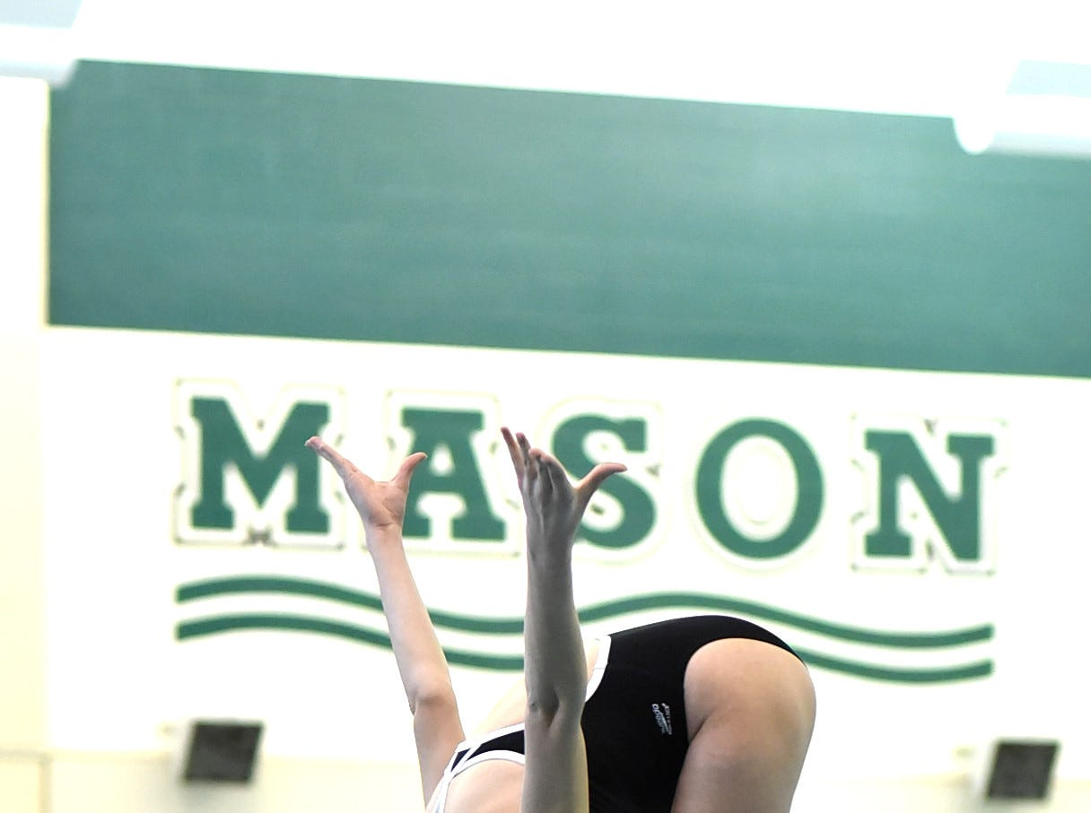 Mason's Lauren Lombardo eyes her entry to the pool during preliminary diving at the Southwest Ohio Swimming and Diving Classic, January 19, 2019.