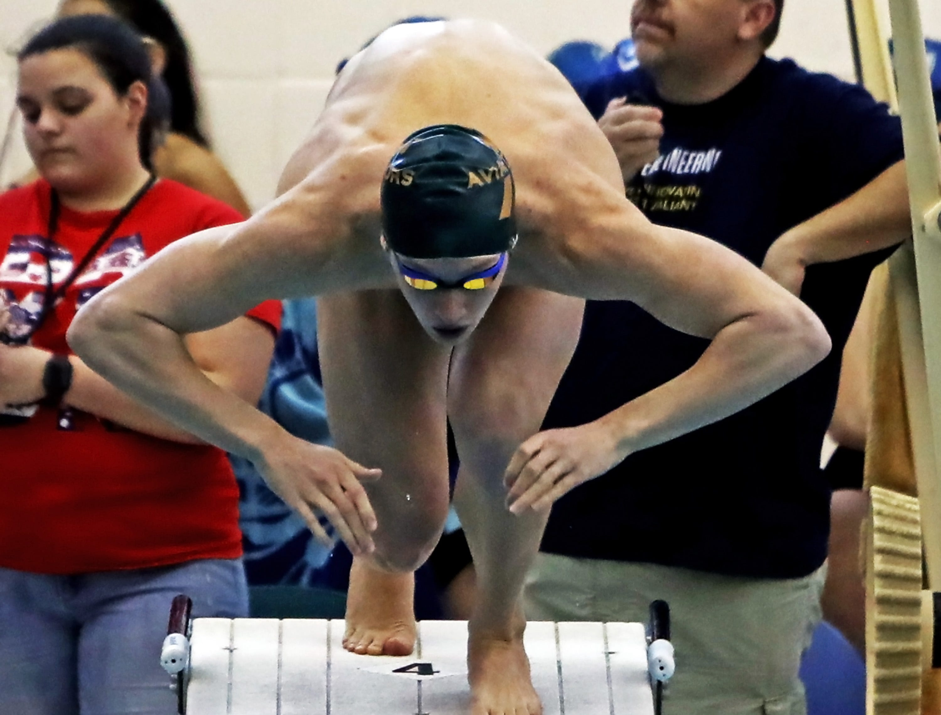 Jake Foster from Sycamore explodes off the starting platform in the boys 200-yard breast stroke at the SW Ohio Swim Classic at Mason.