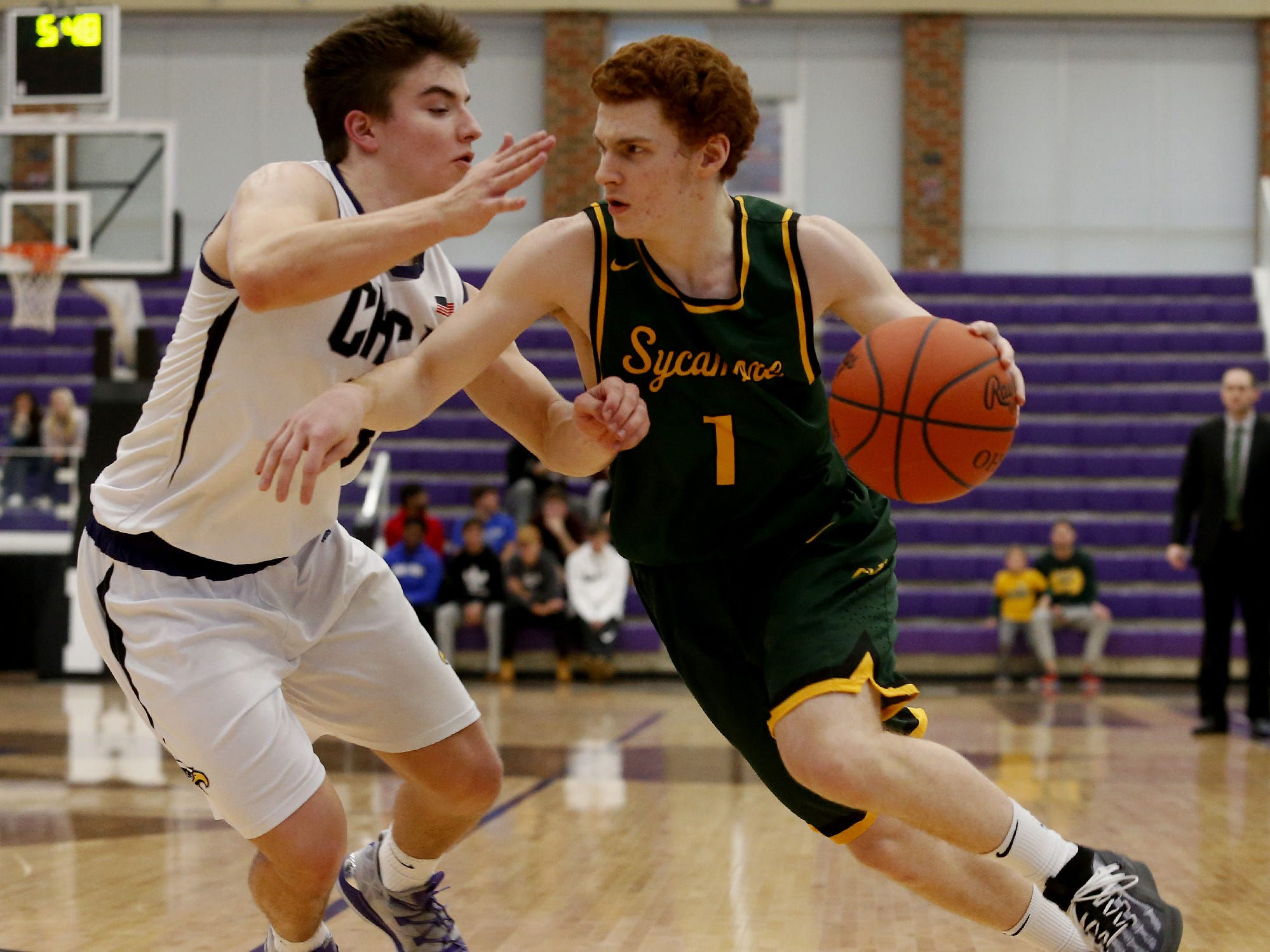 Sycamore guard Oliver Wittenbaum drives on Cincinnati Hills Christian Academy guard Cole Fisher during the Midwest King Classic at Jerry Lucas Court in Wade E. Miller Arena in Middletown Saturday, Jan. 19, 2019.
