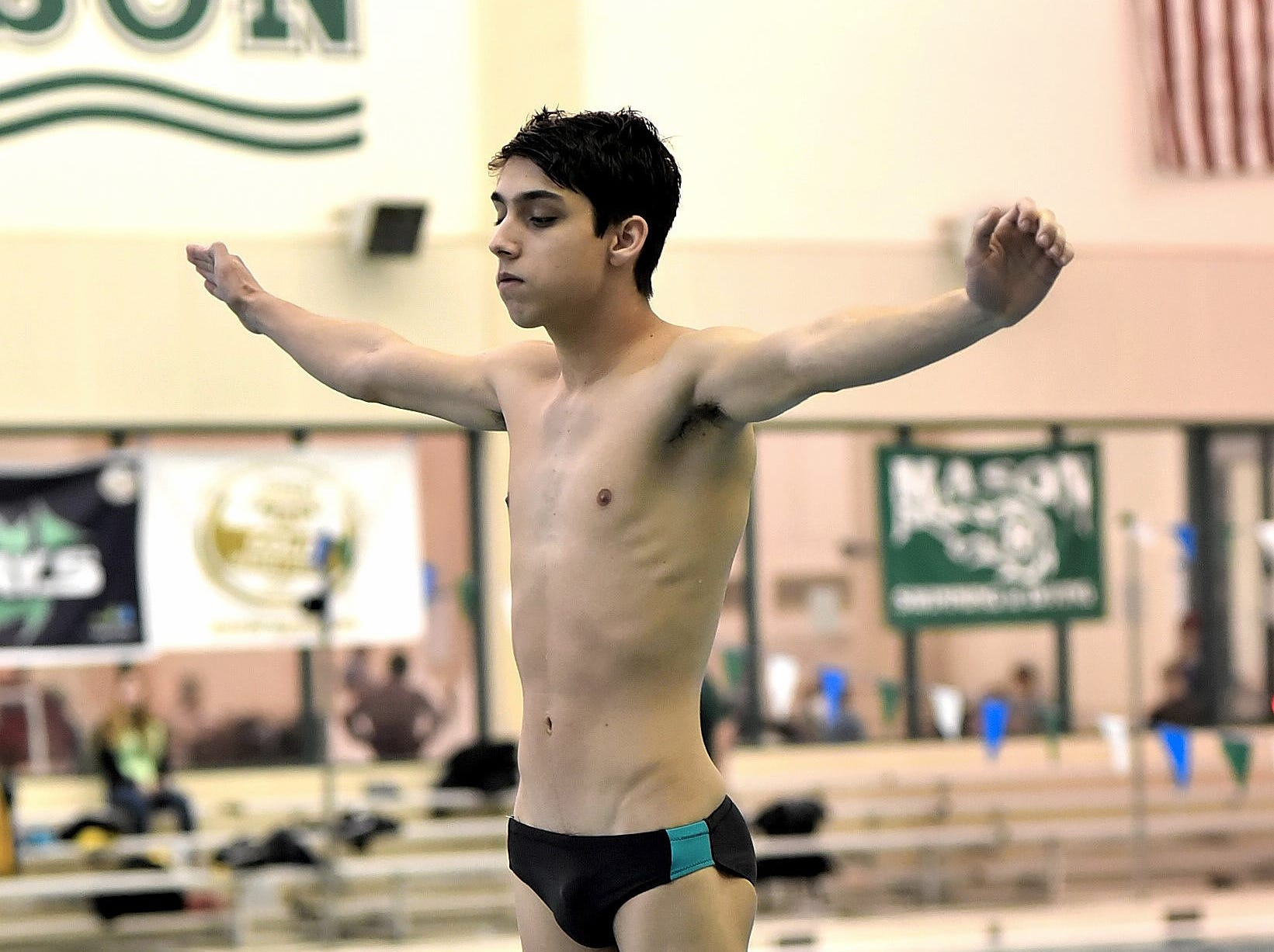 Matthew Wagner of Mason is locked on as he readies another preliminary dive at the Southwest Ohio Swimming and Diving Classic, January 19, 2019.