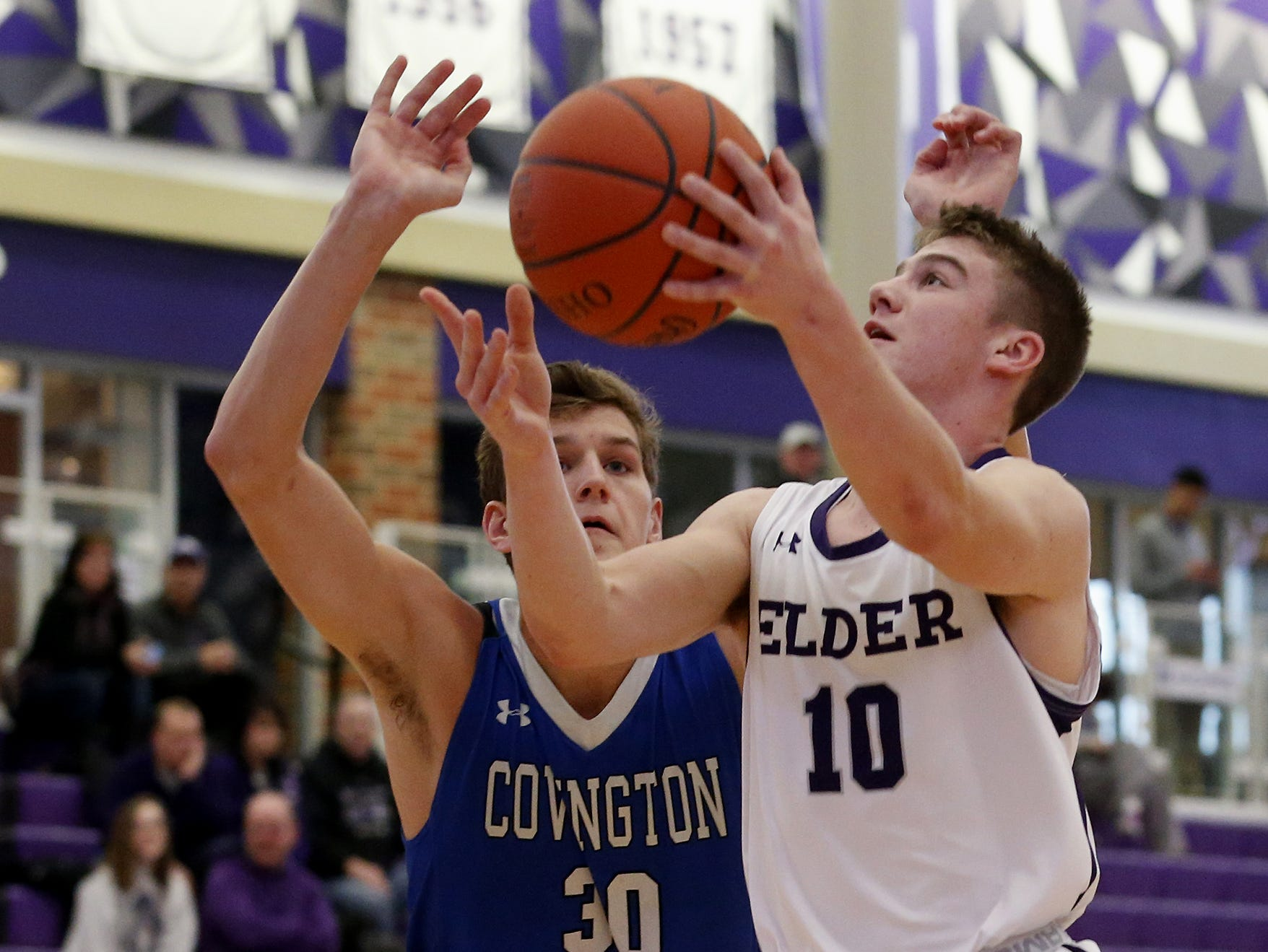 Elder guard Matthew Luebbe goes up to score against Covington Catholic forward Nick Thelen during the Midwest King Classic at Jerry Lucas Court in Wade E. Miller Arena in Middletown Saturday, Jan. 19, 2019.