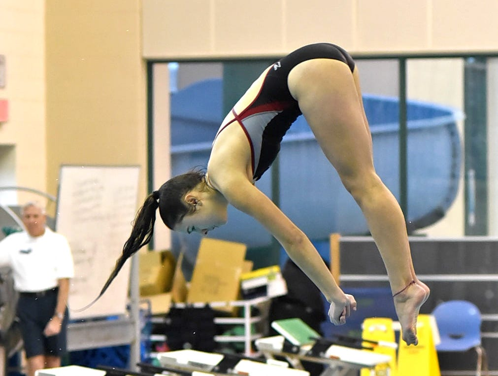 Celia Ball of Kings gets in a warm-up dive before the start of preliminaries at the Southwest Ohio Swimming and Diving Classic, January 19, 2019.
