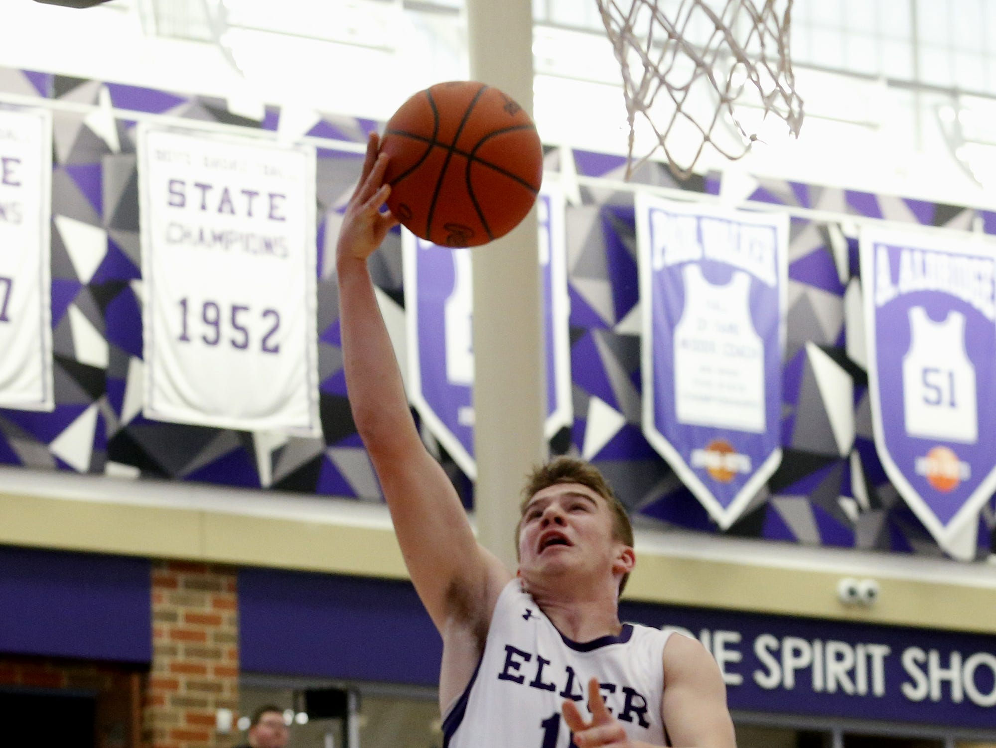 Elder guard Matthew Luebbe scores two against Covington Catholic during the Midwest King Classic at Jerry Lucas Court in Wade E. Miller Arena in Middletown Saturday, Jan. 19, 2019.