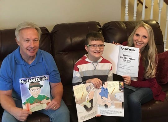 An Ohio boy diagnosed with leukemia became a character in a children's book with the help of a Cincinnati-based nonprofit. Eleven-year-old Matthew Harrison is pictured with writer Sarah Curry Rathel and illustrator Robert Kelly.