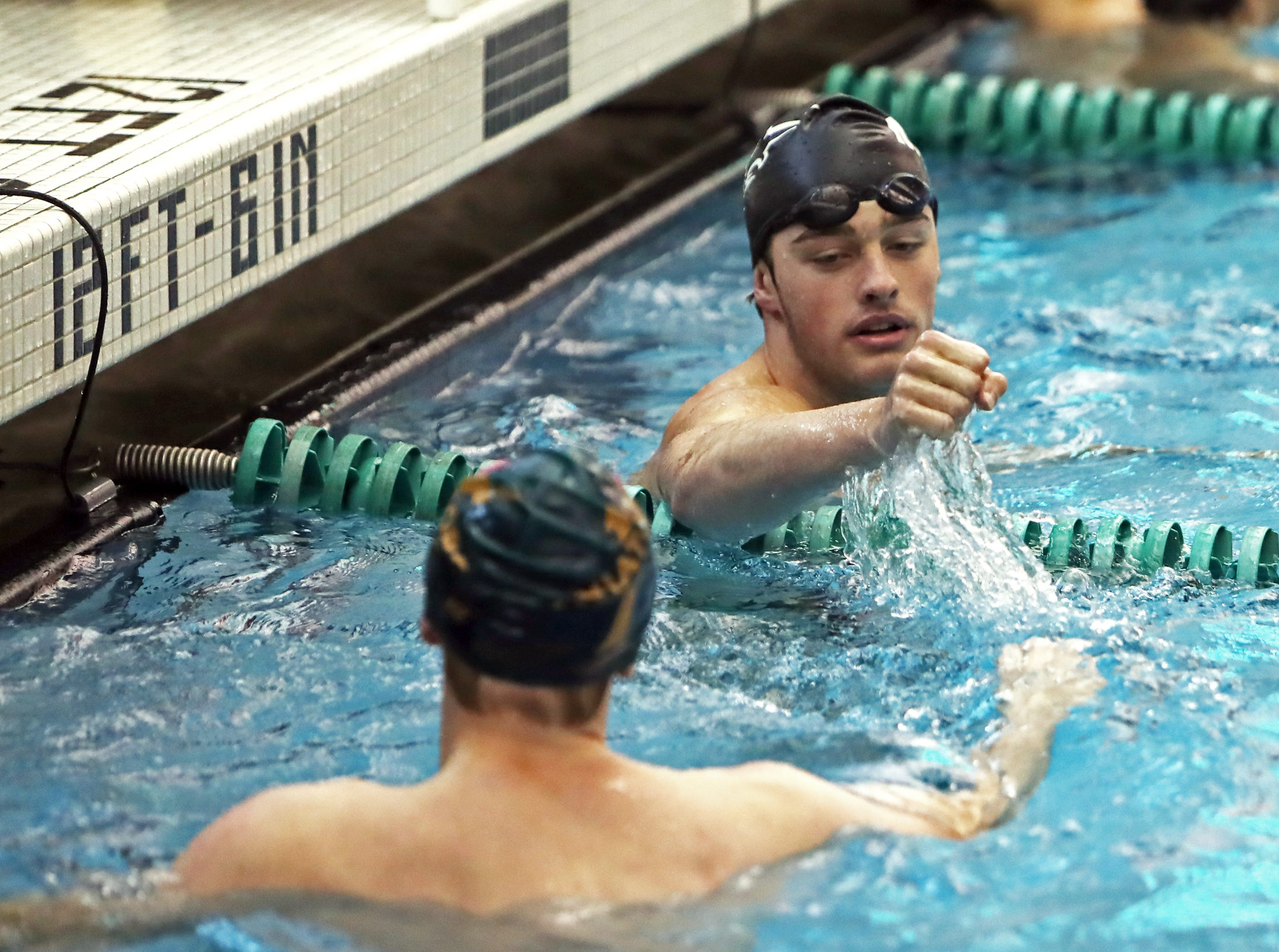 Adam Chaney from Mason [top] and Carl Elliot from Sycamore finish 1-2 in their preliminary heat of the boys 50-yard free style at the SW Ohio Swim Classic at Mason.