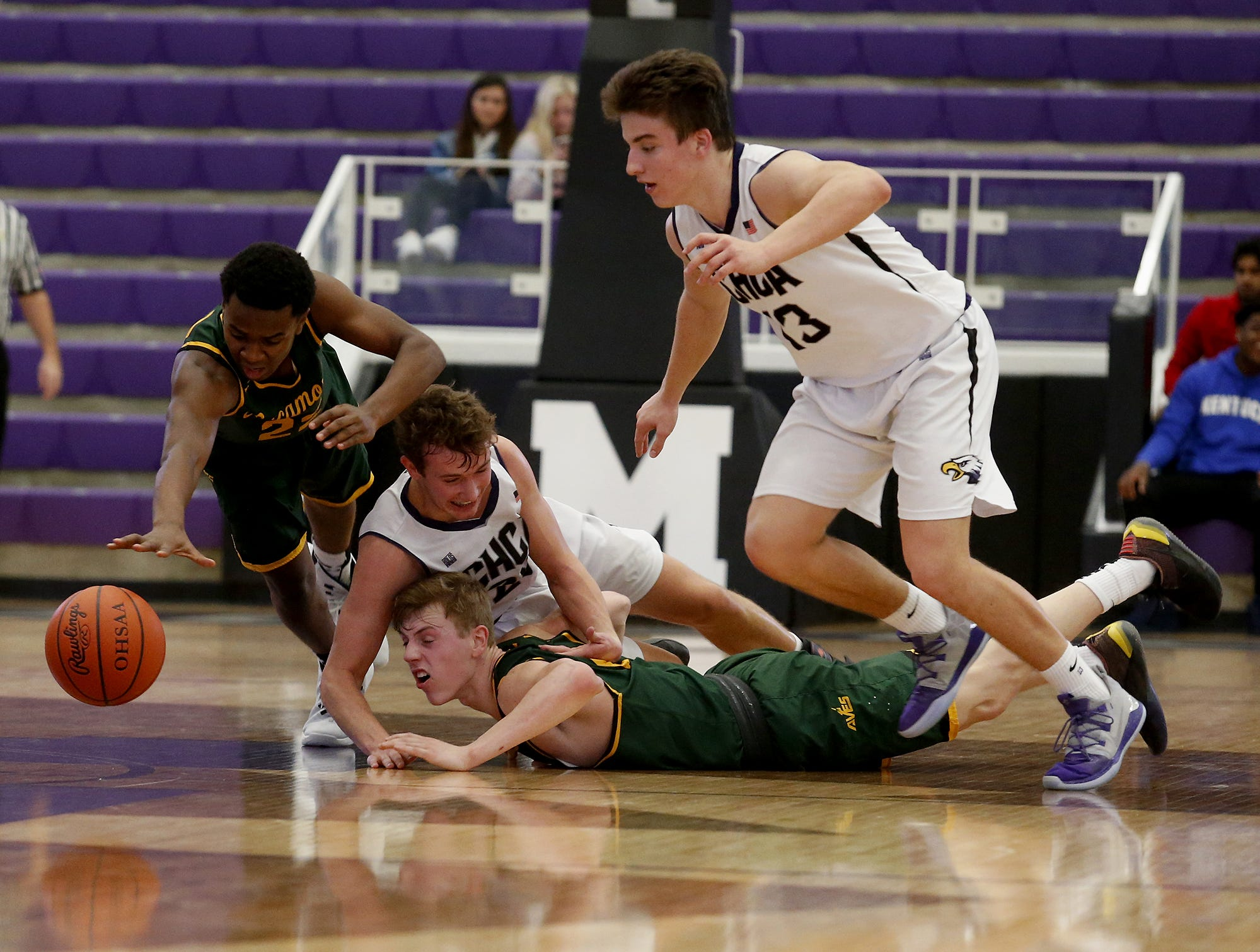 Cincinnati Hills Christian Academy and Sycamore chase a loose ball during the Midwest King Classic at Jerry Lucas Court in Wade E. Miller Arena in Middletown Saturday, Jan. 19, 2019.