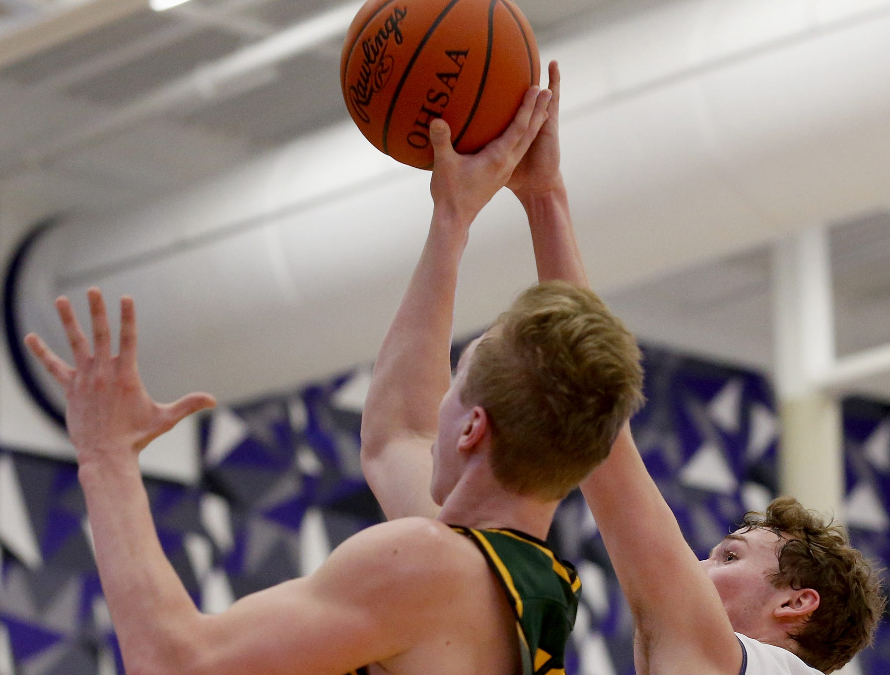 Cincinnati Hills Christian Academy point guard Austin Arthurs blocks the shot of Sycamore guard Ben Yuskewich during the Midwest King Classic at Jerry Lucas Court in Wade E. Miller Arena in Middletown Saturday, Jan. 19, 2019.