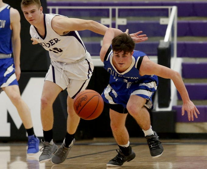 Covington Catholic guard Grant Disken chases a loose ball against Elder during the Midwest King Classic at Jerry Lucas Court in Wade E. Miller Arena in Middletown Saturday, Jan. 19, 2019.