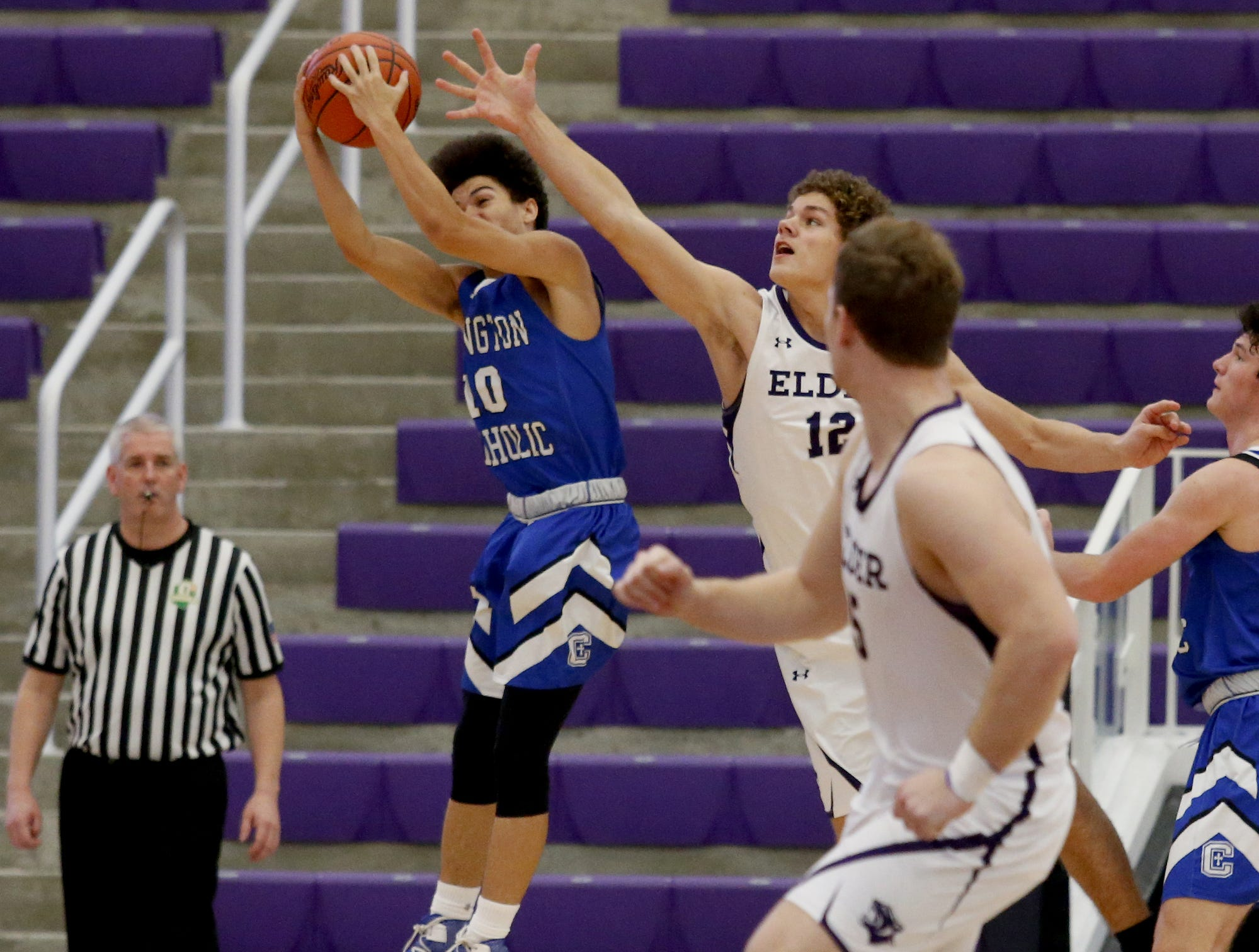 Covington Catholic guard Jalen Bowles grabs a defensive rebound in front of Elder center Joe Royer during the Midwest King Classic at Jerry Lucas Court in Wade E. Miller Arena in Middletown Saturday, Jan. 19, 2019.