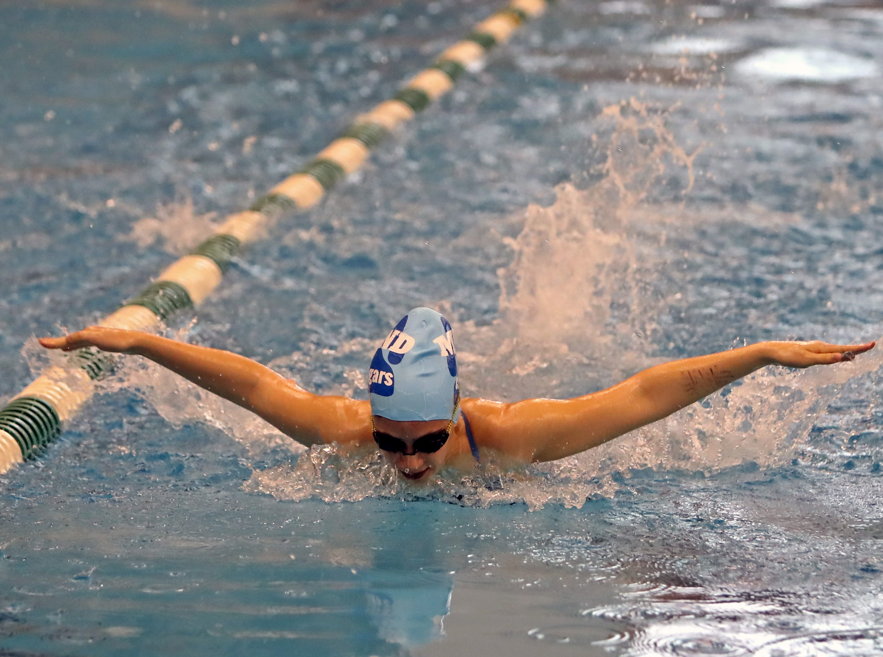 Lahna MCann from Mount Notre Dame competes in the girls 100-yard butterfly at the SW Ohio Swim Classic at Mason.