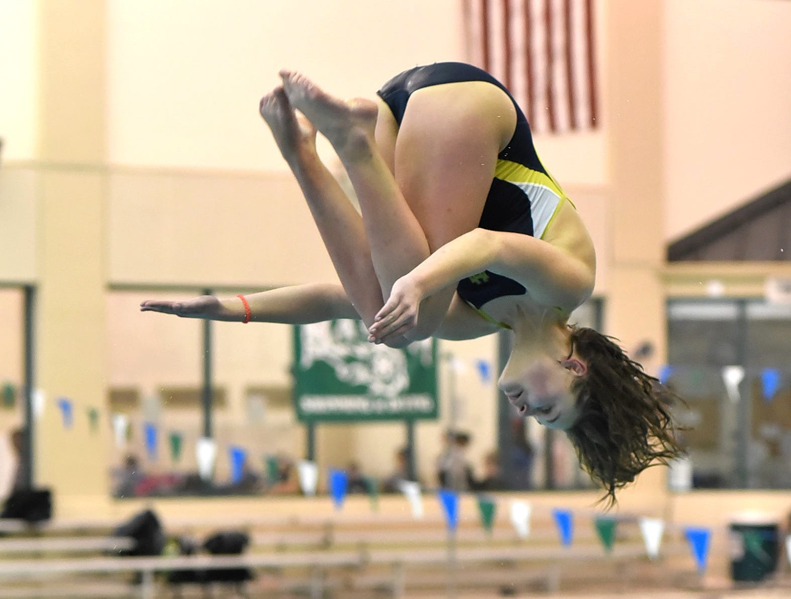Isabel Nissley of Walnut Hills comes out of her tuck while diving at the Southwest Ohio Swimming and Diving Classic, January 19, 2019.