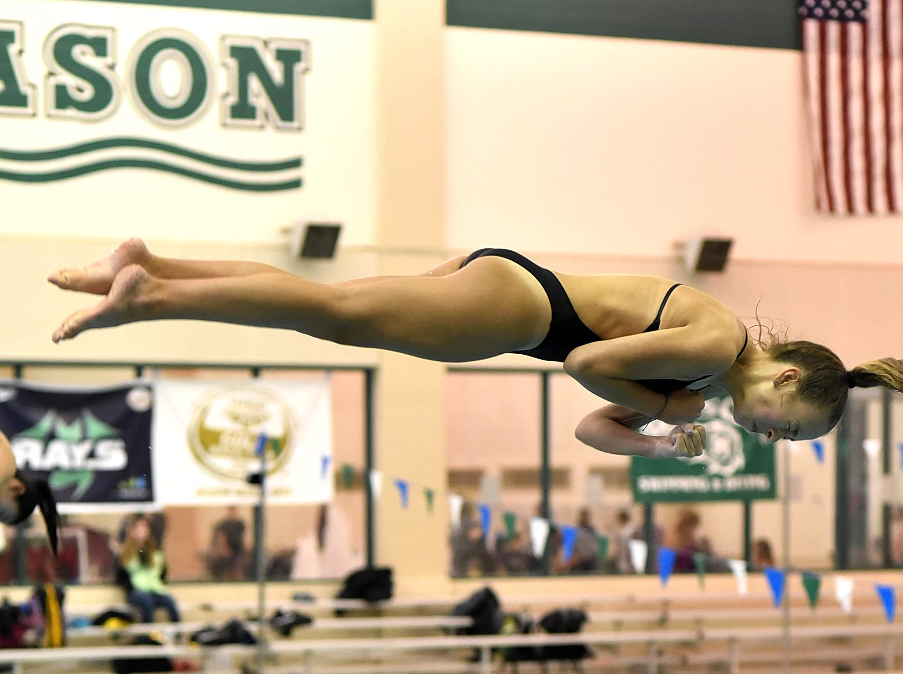 Gracie Brossart of Mason is eyes wide shut and in horizontal form at the Southwest Ohio Swimming and Diving Classic, January 19, 2019.