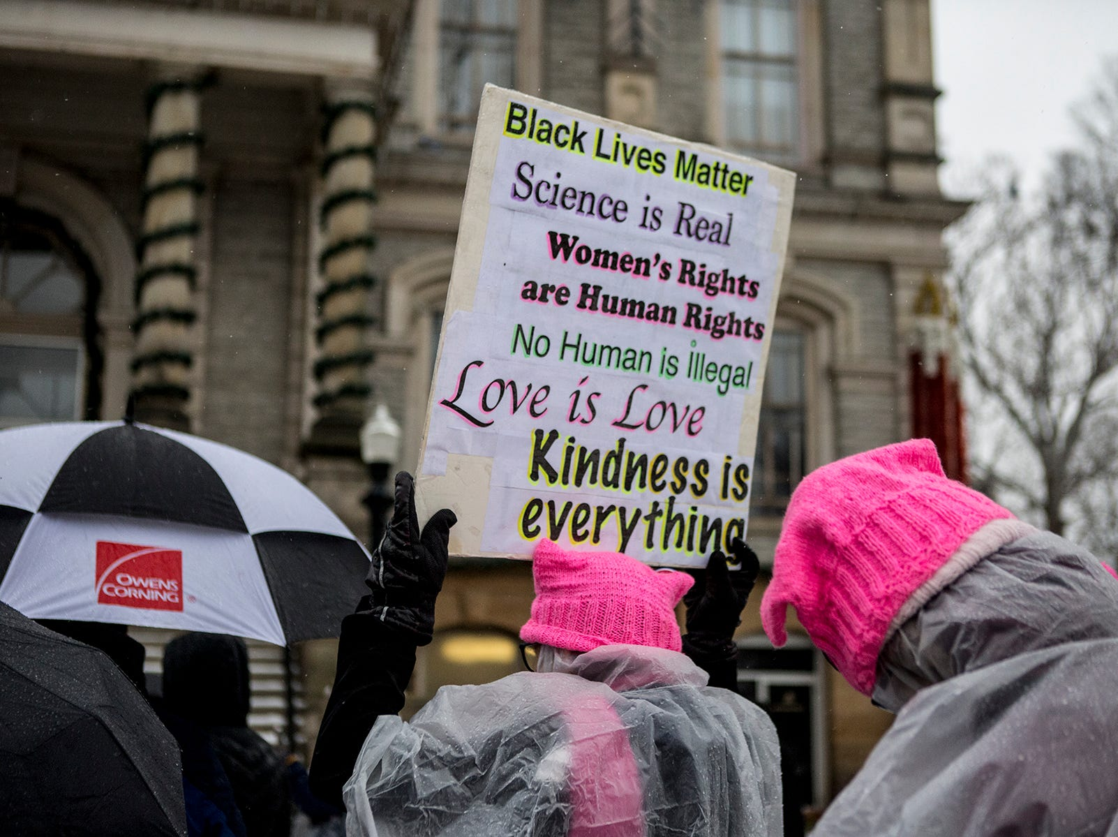 Around 50 people braved the cold rain and threat of a snowstorm to turn out for the Women's March in downtown Newark, January 19.
