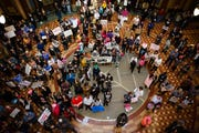 Protesters fill the rotunda at the Iowa State Capitol for the third Women's March on Saturday, Jan. 19, 2019, in Des Moines.
