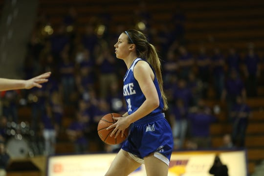 Drake's Nicole Miller looks to pass against Northern Iowa Friday at the McLeod Center