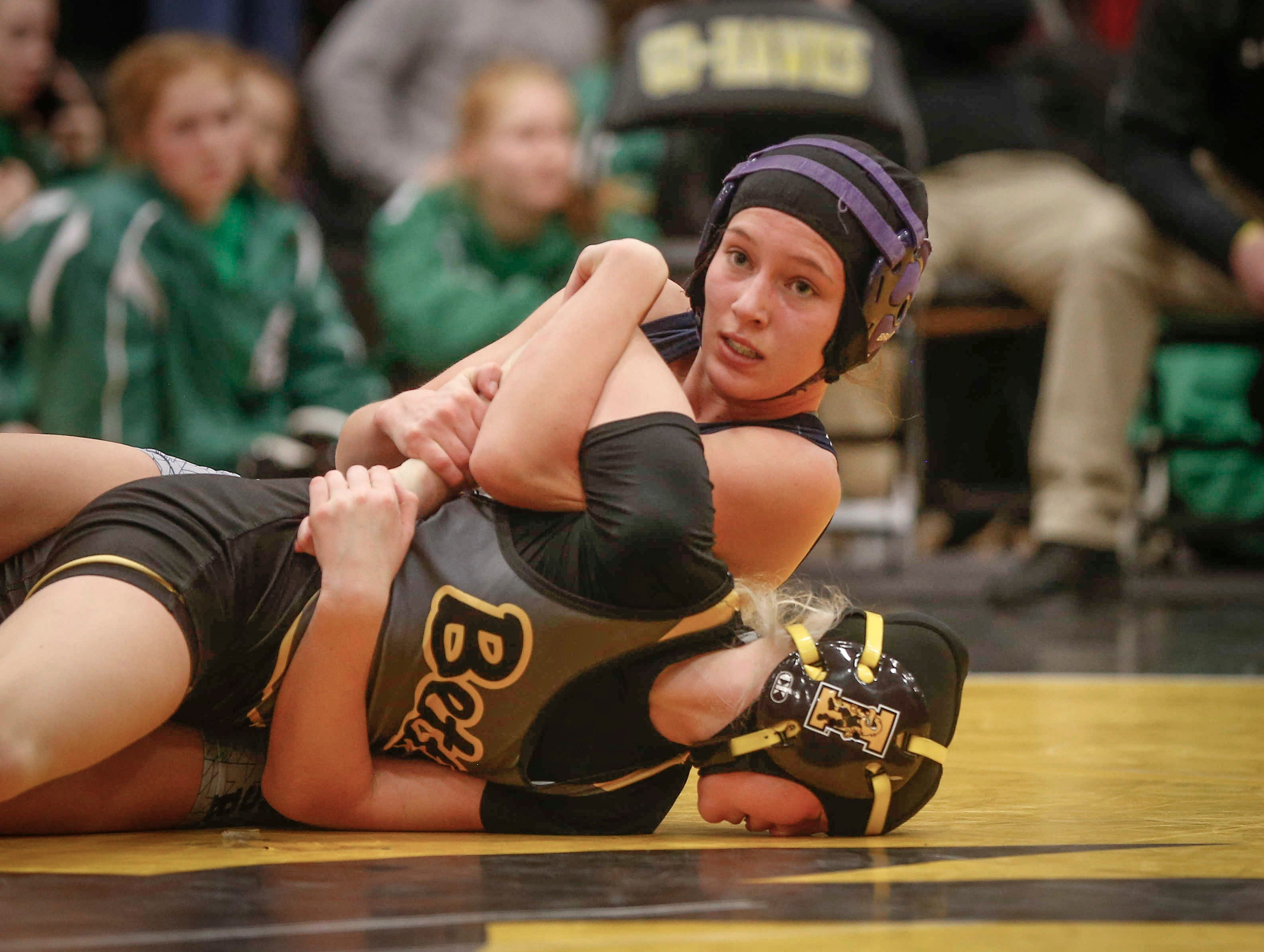 AGWSR junior Ali Gerbracht looks up at the clock while controlling Bettendorf's Ella Schmit in their match at 106 pounds on Saturday, Jan. 19, 2019, during the first Iowa girls state wrestling tournament at Waverly-Shell Rock High School in Waverly. Gerbracht won and went down in state history as the first Iowa high school girl state wrestling champion.