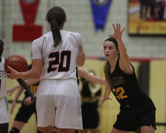 Southeast Polk's Maggie McGraw (32) defends Des Moines East's Justice Ross (20) in a Jan. 14 game. McGraw had 20 points to lead the Rams to a 68-64 win against Mason City last week.