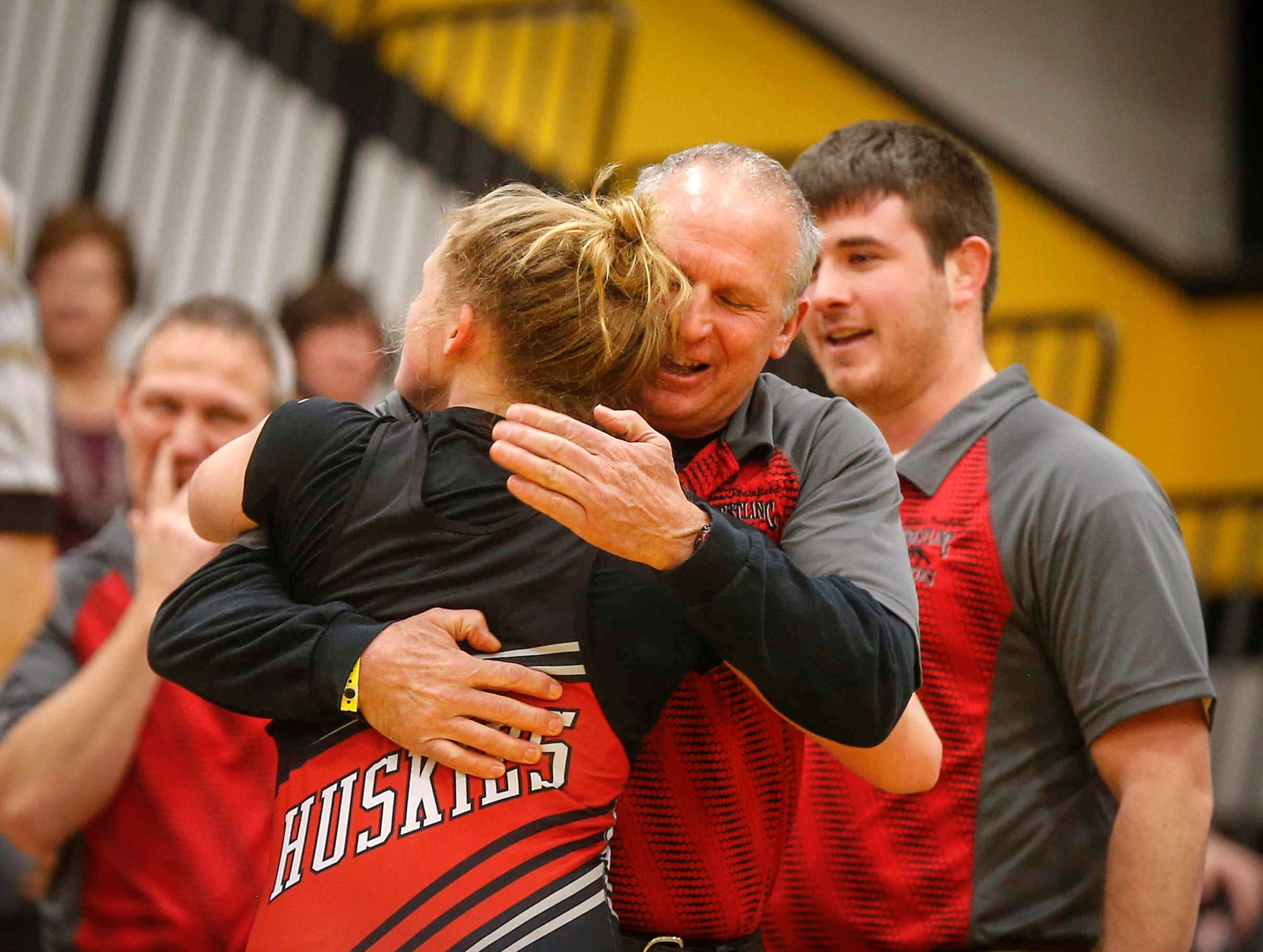 Nashua-Plainfield wrestling coach Al Frost hugs sophomore Toyia Griffin pinned Waverly-Shell Rock's Hedda Kveum in 16 seconds of the first period to win a state title at 152 pounds on Saturday, Jan. 19, 2019, during the first Iowa girls state wrestling tournament at Waverly-Shell Rock High School in Waverly.