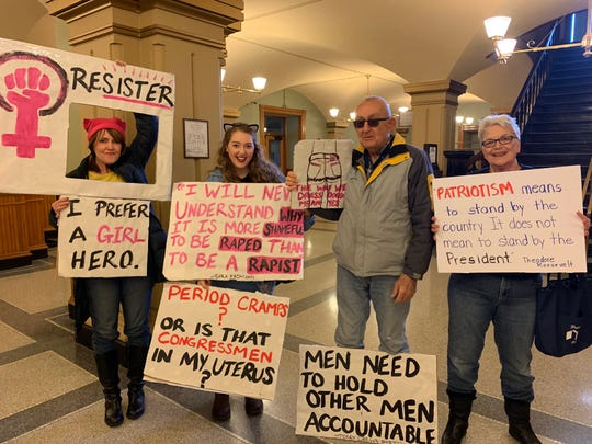 From left: Heidi Schoeneck of Des Moines; Katelyn Brockmeyer, a UNI student from Okoboji; and Carol and Brenda Schumann of Des Moines hold their signs at the Women's March in the Iowa State Capitol on Saturday, Jan. 19, 2019.
