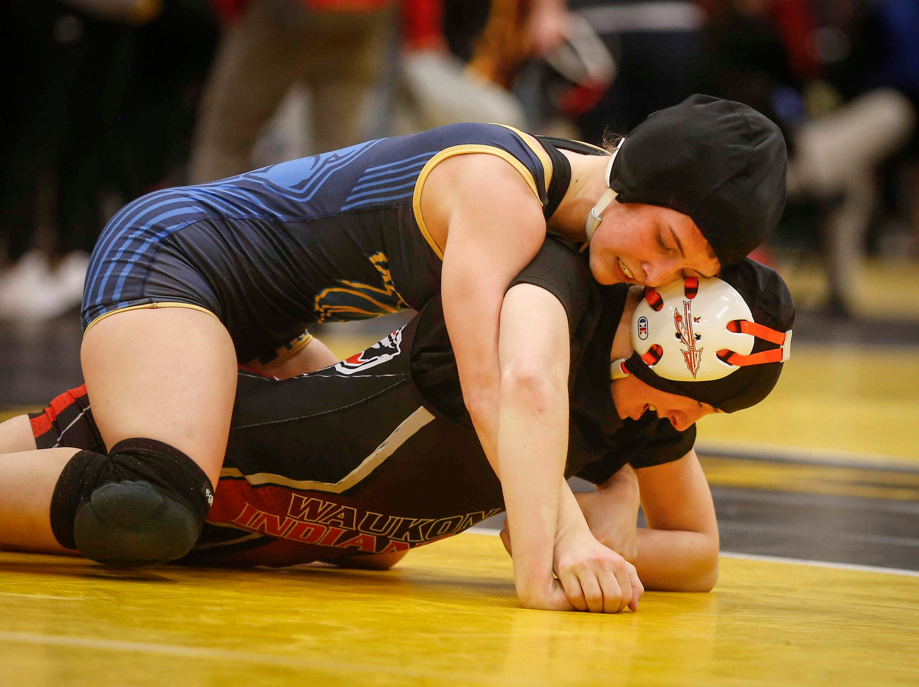 Davenport North junior Tateum Park controls Waukon's Meridian Snitker for a 113-pound state championship win on Saturday, Jan. 19, 2019, during the first Iowa girls state wrestling tournament at Waverly-Shell Rock High School in Waverly.