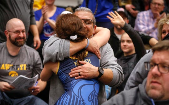 Davenport North junior Tateum Park gets a hug after her win over Waukon's Meridian Snitker for a 113-pound state championship on Saturday, Jan. 19, 2019, during the first Iowa girls state wrestling tournament at Waverly-Shell Rock High School in Waverly.