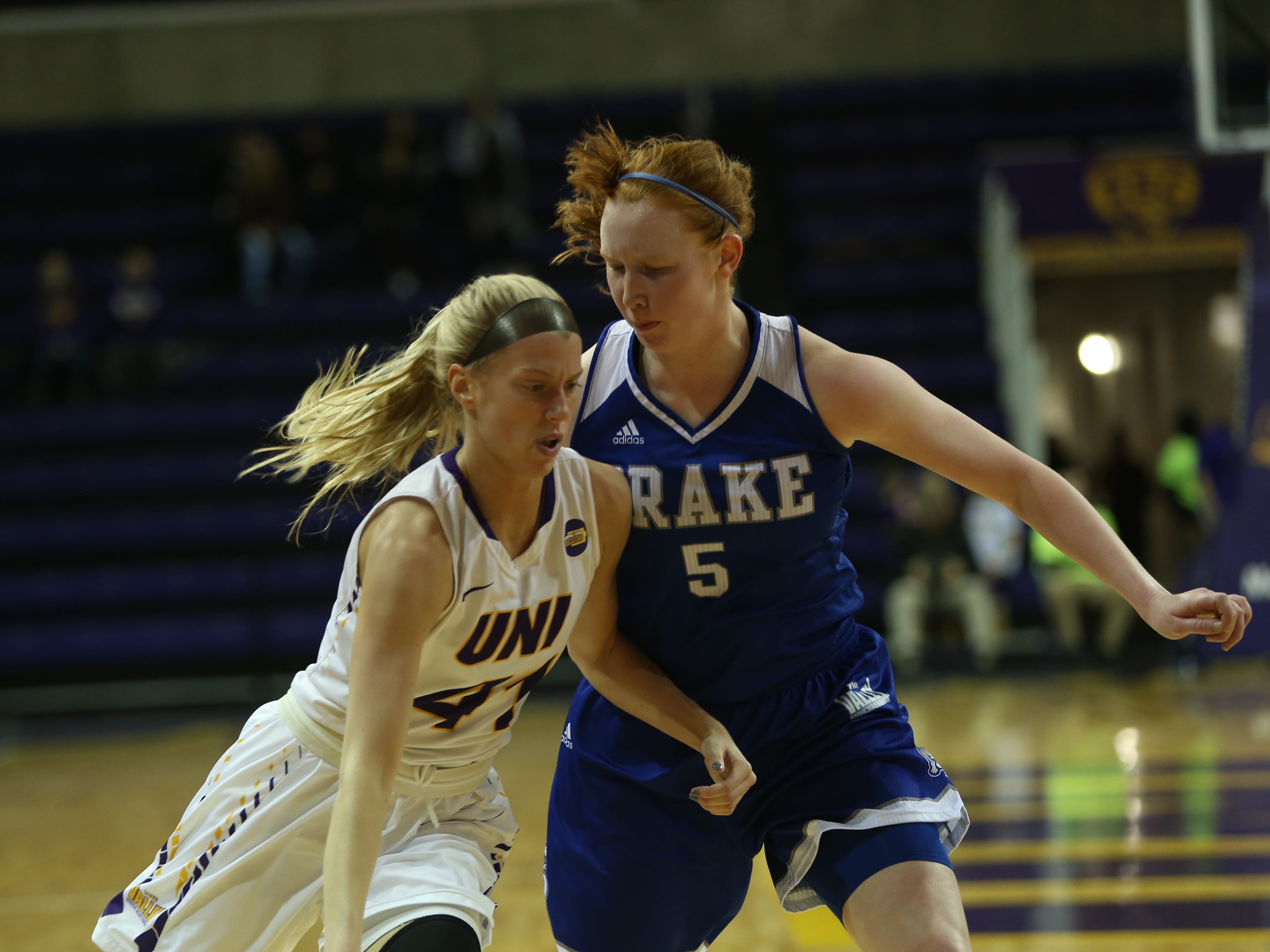 Northern Iowa's Abby Gerrits drives against Drake's Becca Hittner Friday at the McLeod Center.