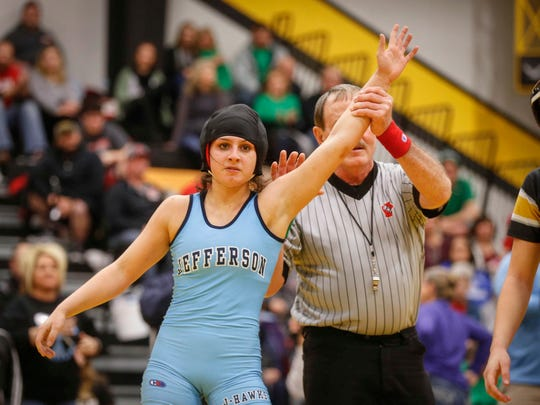 Cedar Rapids Jefferson junior Chloe Clemons won a state title at 120 pounds over Waverly-Shell Rock's Jacey Meier on Saturday, Jan. 19, 2019, during the first Iowa girls state wrestling tournament at Waverly-Shell Rock High School in Waverly.