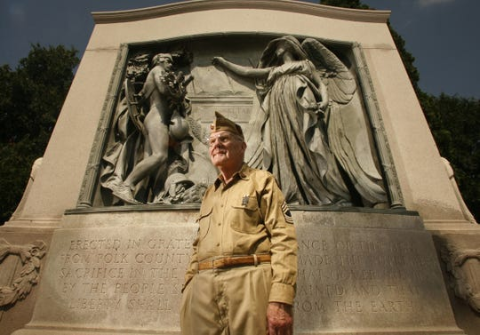 Gerald LaBlanc stands in front of the Iowa Gold Star Monument near Iowa Lutheran Hospital in 2007. LaBlanc died in 2018 at age 88.